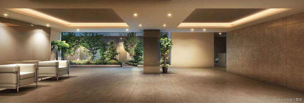 エントランスホール完成予想図<br /> 広々と開放的なホールの床と壁には、艶を抑えたマットな質感のタイルを使用。<br /> 心を和ませる緑景を取り込むなど、洗練された優しい空間を演出しています。